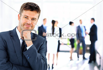 Portrait of young handsome businessman in office