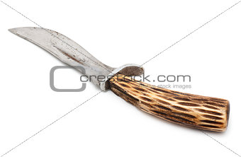 Old knife with a handle made of moose antlers, isolated