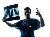 doctor surgeon radiologist gesturing okay examining lung torso
