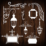 Retro street lanterns on wooden backdrop