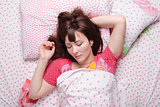 Girl of twenty-five years sleeping in bed