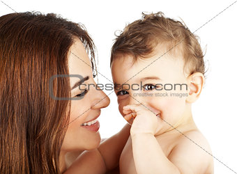 Adorable baby boy smiling with mother