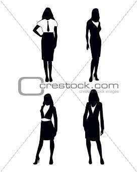 Four businesswoman silhouettes