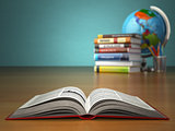 Concept of education. Open book wich pencils and globe.