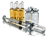 Medicine concept. Syringe and ampoules or vials isolated on whit