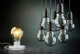 Idea or leadership concept. Group of lightbulbs on the black bac