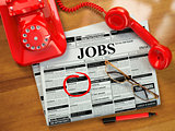 Looking for a job. Jobs vacancies. Newspaper with advertisments,