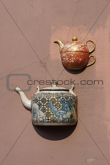 Ancient teapots on facade of old building in Vilnius, Lithuania.