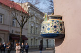 Ancient teapot on facade of old building in Vilnius, Lithuania.