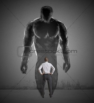 Businessman and strong shadow