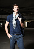 Fashion shot: handsome young man wearing shirt, scarf and jeans