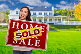 Mixed Race Female with Sold Sign In Front of House
