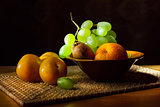 Still life. Fruit on a wicker tray