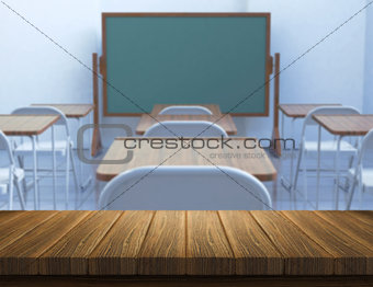 3D wood table with defocussed classroom