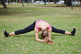Woman stretching in the park before Exercise.