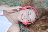 Beautiful woman with headphones outdoors.