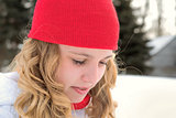 Teenage girl with red cap