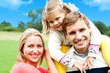 Beautiful happy caucasian family of three
