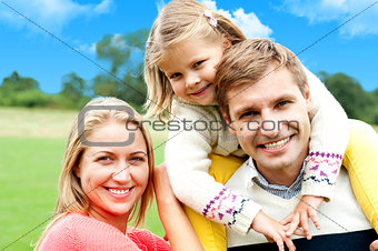 Beautiful happy caucasian family of three