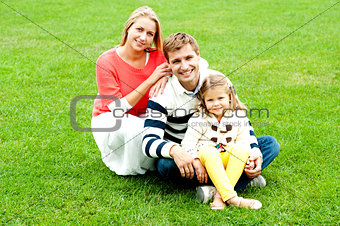 Portrait of happy young family with daughter