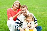 Outdoor happy caucasian family relaxing