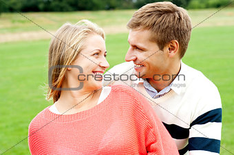Couple admiring each other and smiling heartily