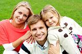 Joyous family of three. Loving and caring