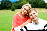 Lovely young couple striking a smiling pose