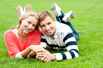 Attractive smiling young couple with strong bonding