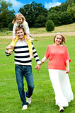 Portrait of family of three. Outdoor