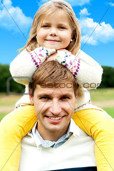 Charming little girl posing with her father