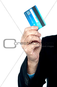 Cropped image of a man showing credit card