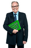 Senior male manager holding big green calculator