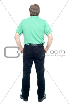 Back pose of a senior man looking at the wall