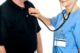 Cropped image of doctor examining a patient