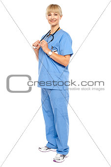 Casual portrait of a confident physician standing sideways