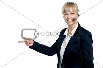 Active employee pointing towards the copy space area