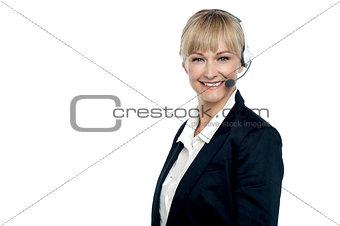 Corporate telecaller smiling confidently