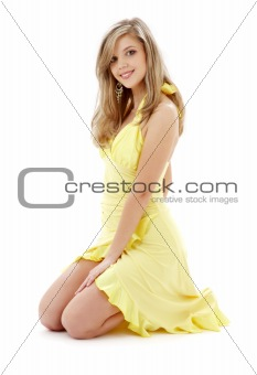kneeled girl in yellow dress