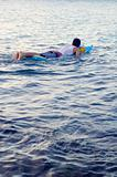 Boy swimming on a raft