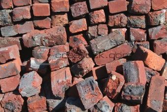 Old red brick pile background