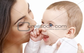 smiling baby in mother hands