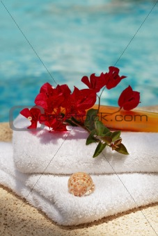 Towels by swimming pool