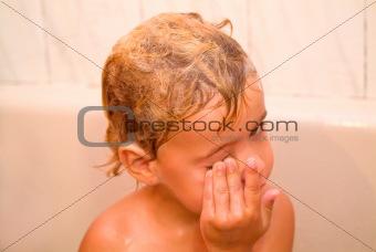 boy laughing in bathroom