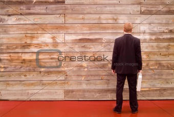 business man facing a wall