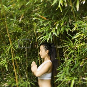 Asian woman meditating.
