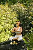 Asian woman meditating.