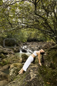 Asian woman doing yoga.
