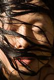 Womans face and wet hair.