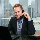 Businessman on phone in office.